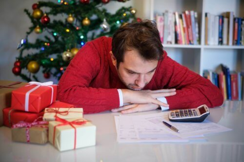 Man worried and without money for buying christmas present. Debt Holiday.